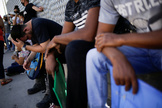 """lt;HIT gt;Migrants lt;/HIT gt; in the """"Remain in Mexico"""" program queue outside the premises of the National Migration Institute (INM) to renew their permission to stay legally in Mexico to wait for their immigration hearing in the U.S., in Ciudad Juarez"""