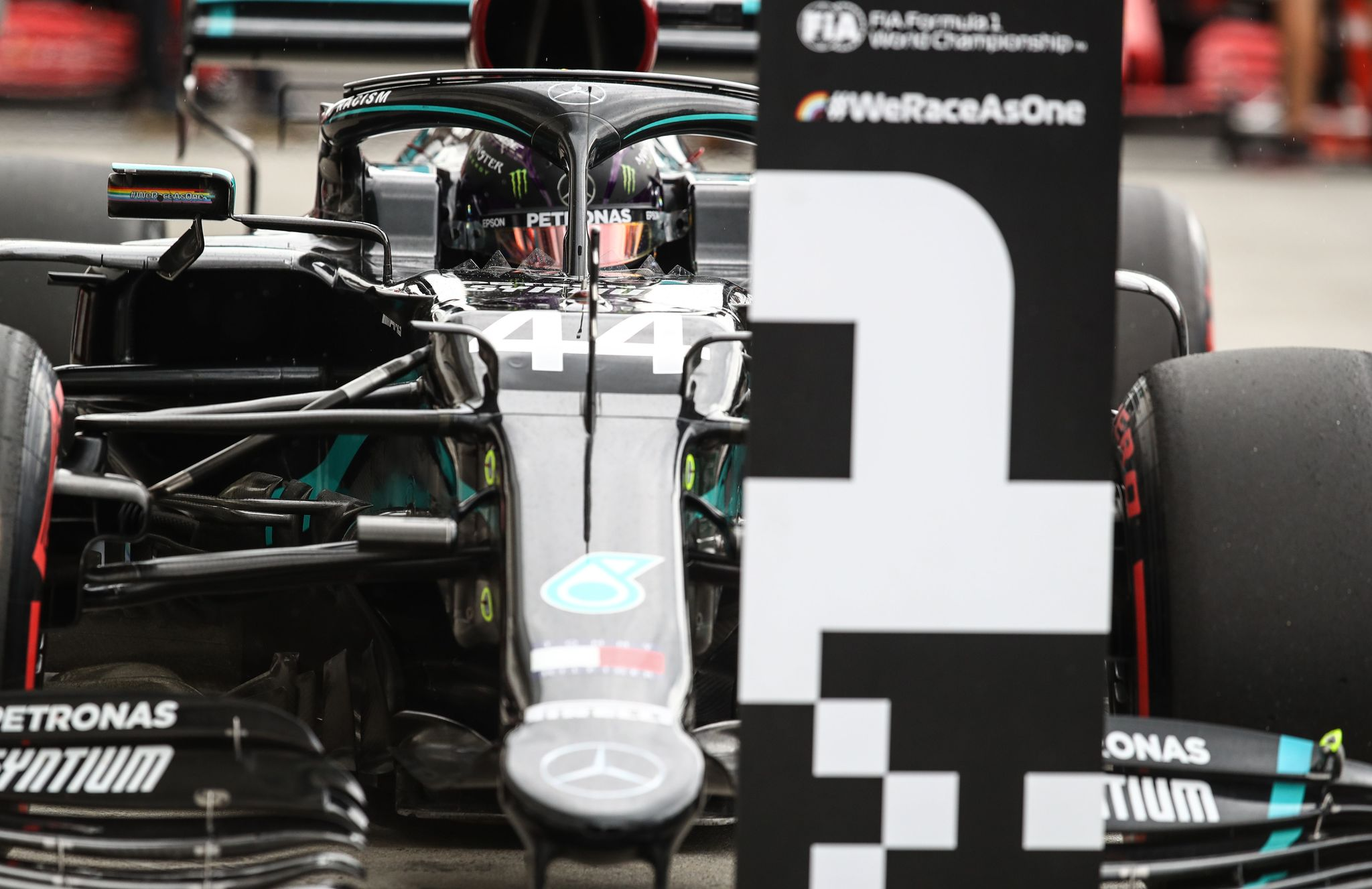 lt;HIT gt;Mercedes lt;/HIT gt;' British driver Lewis lt;HIT gt;Hamilton lt;/HIT gt; stands in the pit after the qualifying session for the Formula One Hungarian Grand Prix at the Hungaroring circuit in Mogyorod near Budapest, Hungary, on July 18, 2020. (Photo by Mark Thompson / POOL / AFP)