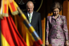 (FILES) In this file photo taken on October 19, 2009 King Juan Carlos I of Spain (L) and Queen lt;HIT gt;Sofia lt;/HIT gt; attend a military parade at the El Pardo palace in Madrid. - Spain's former king Juan Carlos, who is under investigation for corruption, has announced he plans to go into exile, the royal palace said on August 3, 2020. (Photo by Pierre-Philippe MARCOU / AFP)