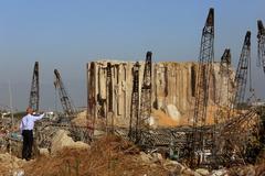 A man stands near the damaged grain silos following Tuesday's blast at lt;HIT gt;Beirut lt;/HIT gt;'s port area