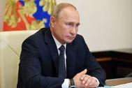 El presidente ruso, Vladimir Putin, en una teleconferencia con ministros de su Gobierno.