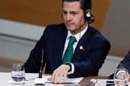 Paris (France), 12/12/2017.- (FILE) - Mexican President Enrique lt;HIT gt;Pena lt;/HIT gt; lt;HIT gt;Nieto lt;/HIT gt; listens during the Plenary Session of the One Planet Summit at the Seine Musicale event site on the Ile Seguin near Paris, France, 12 December 2017 (reissued 12 August 2020). The Mexican Attorney General's Office has announced that it is investigating allegations that former President Enrique lt;HIT gt;Pena lt;/HIT gt; lt;HIT gt;Nieto lt;/HIT gt; partly financed his 2012 election campaign with bribes from the Brazilian construction company Odebrecht. (Brasil, Francia) EPA/