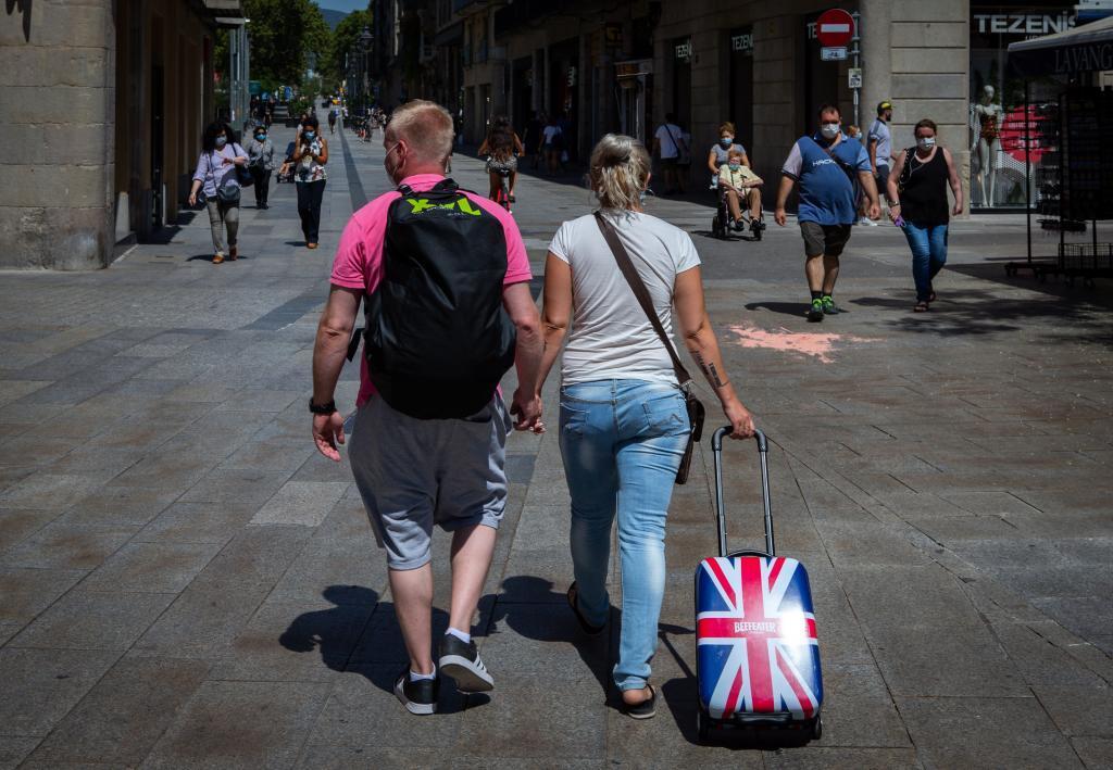 Turistas británicos pasean por el centro de Barcelona