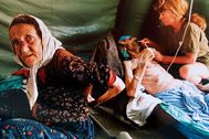 A picture taken on July 11, 1995 shows an elderly lt;HIT gt;Muslim lt;/HIT gt; lt;HIT gt;woman lt;/HIT gt; and her husband getting treatment for injuries inflicted on them by Serb military forces as they fled the east Bosnian enclave of Srebrenica. A Bosnian court on June 15, 2012 convicted four former elite soldiers of crimes against humanity for executing some 800 Bosnian Muslims during the 1995 Srebrenica massacre and sentenced them to up to 43 years. (The man on the right died shortly after the picture was taken). AFP PHOTO/Odd ANDERSEN (Photo by ODD ANDERSEN / AFP) PARA PAPEL CULTURA PABLO