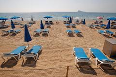 Foto de una de las playas de Benidorm, dividida por parcelas, durante la primera quincena de septiembre.