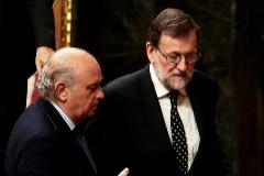 El ex ministro del Interior, Jorge Fernández Díaz, y el ex presidente del Gobierno, Mariano Rajoy.