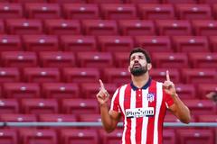 Diego Costa celebra su gol ante el Granada.