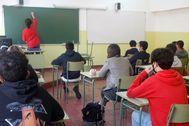 Alumnos de un colegio de Gijón en su vuelta a clase.