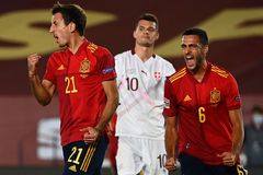 Spain's forward Mikel lt;HIT gt;Oyarzabal lt;/HIT gt; (L) celebrates with Spain's midfielder Mikel Merino after scoring a goal during the UEFA Nations League A group 4 football match between Spain and Switzerland at the Alfredo Di Stefano stadium in Valdebebas in northeastern Madrid on October 10, 2020. (Photo by GABRIEL BOUYS / AFP)