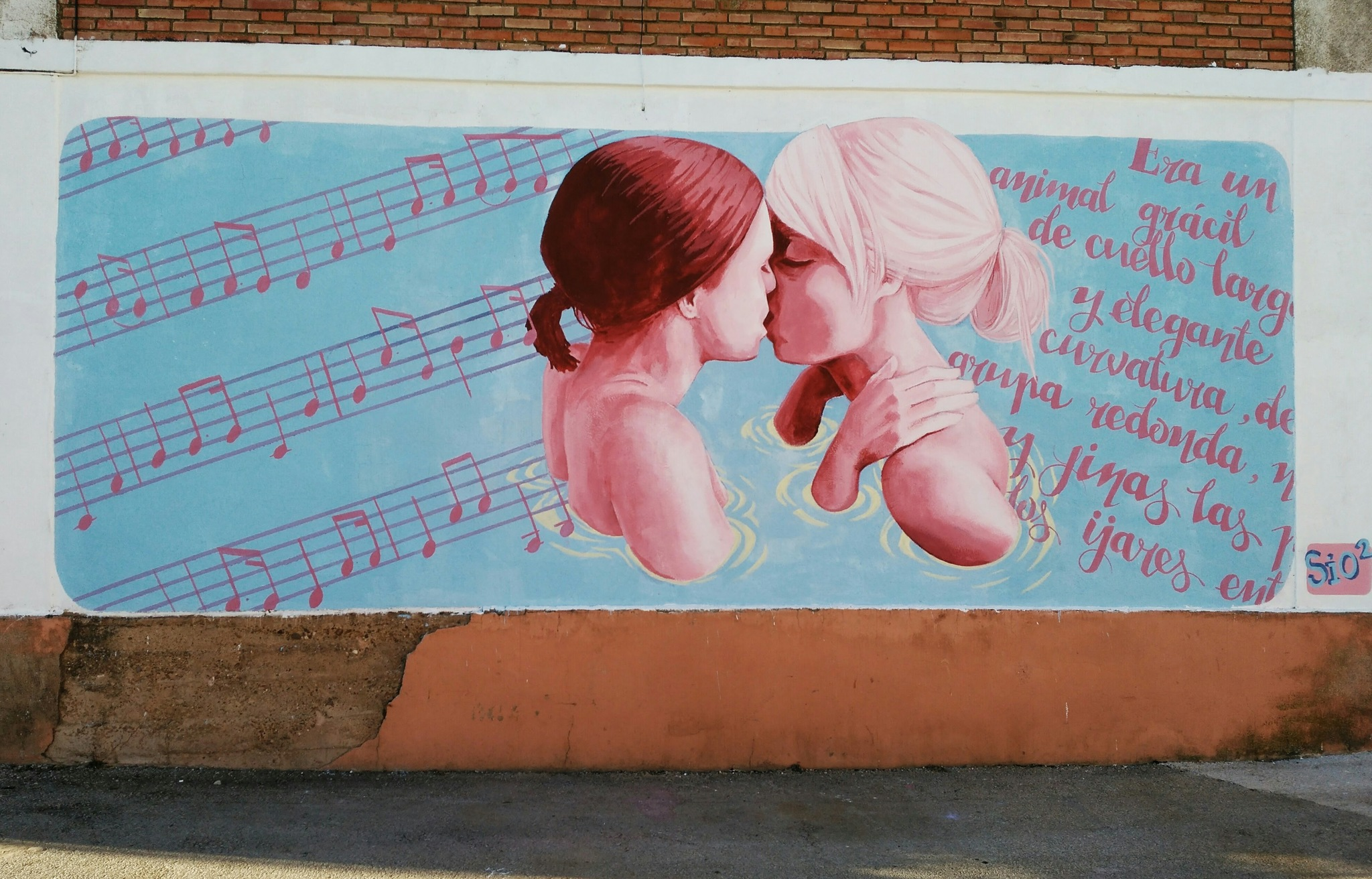 Intervención del colectivo artístico SIO2 en una pared de Villangómez.