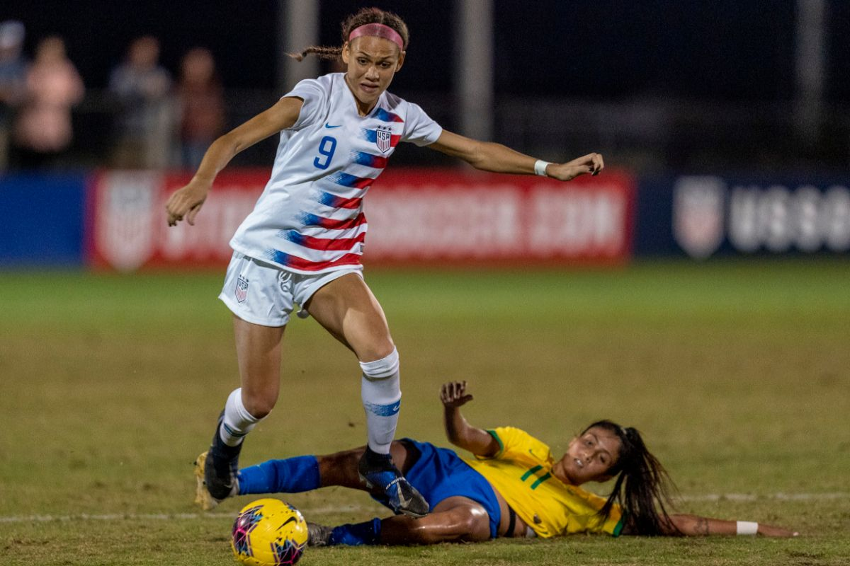 LAKEWOOD RANCH, FL - DECEMBER 11: Trinity lt;HIT gt;Rodman lt;/HIT gt; #9 of the United States steps out of the tackle of Jacqueline Almeida #11 of Brazil during a game between Brazil and USWNT U-20 Blue at Premier Sports Campus on December 11, 2019 in Lakewood Ranch, Florida. (Photo by Brad Smith/ISI Photos/Getty Images)