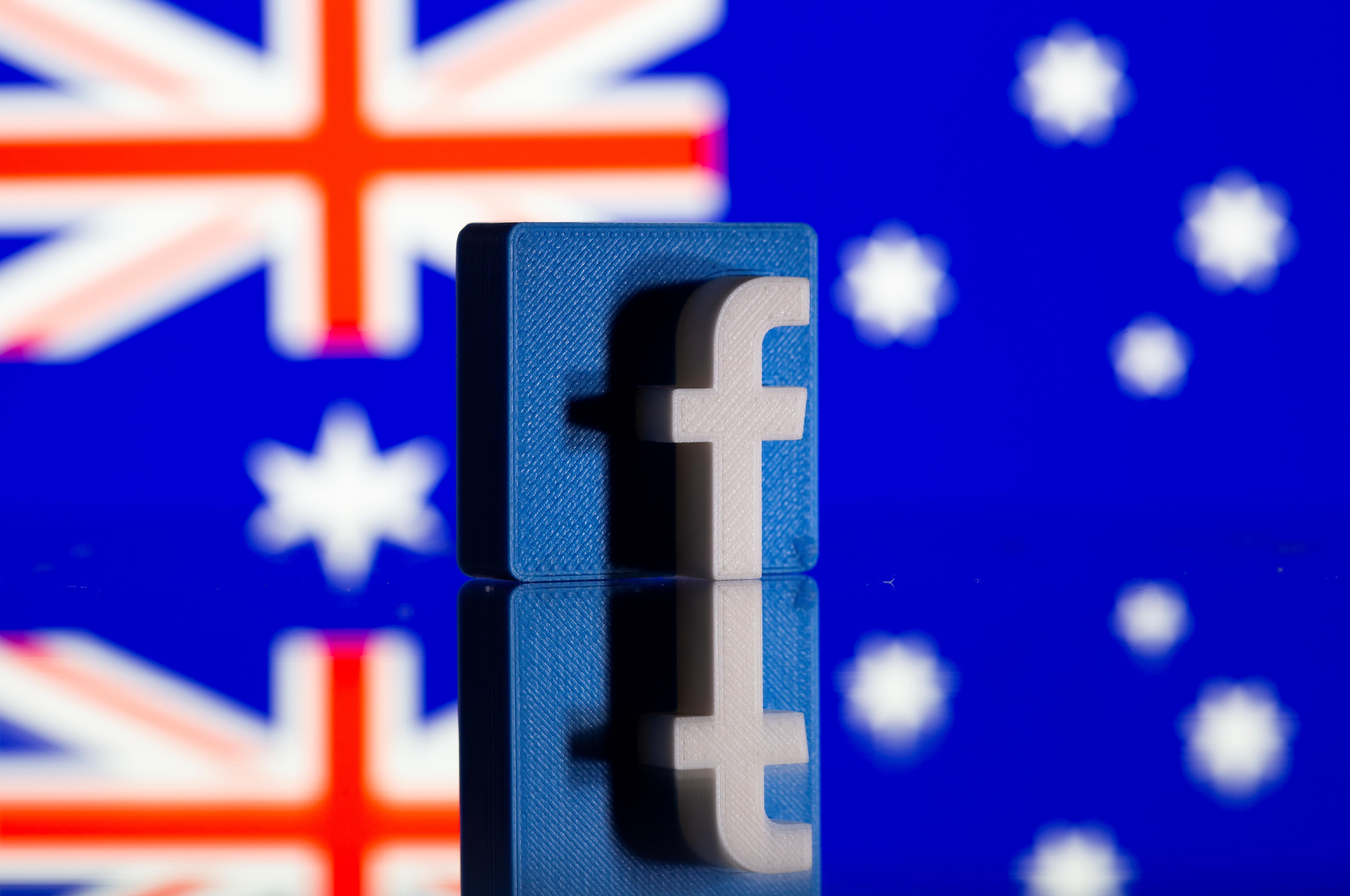 El logotipo de Facebook, delante de una bandera de Australia.