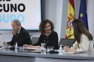 Juan Carlos Campo y María Jesús Montero, en Moncloa.