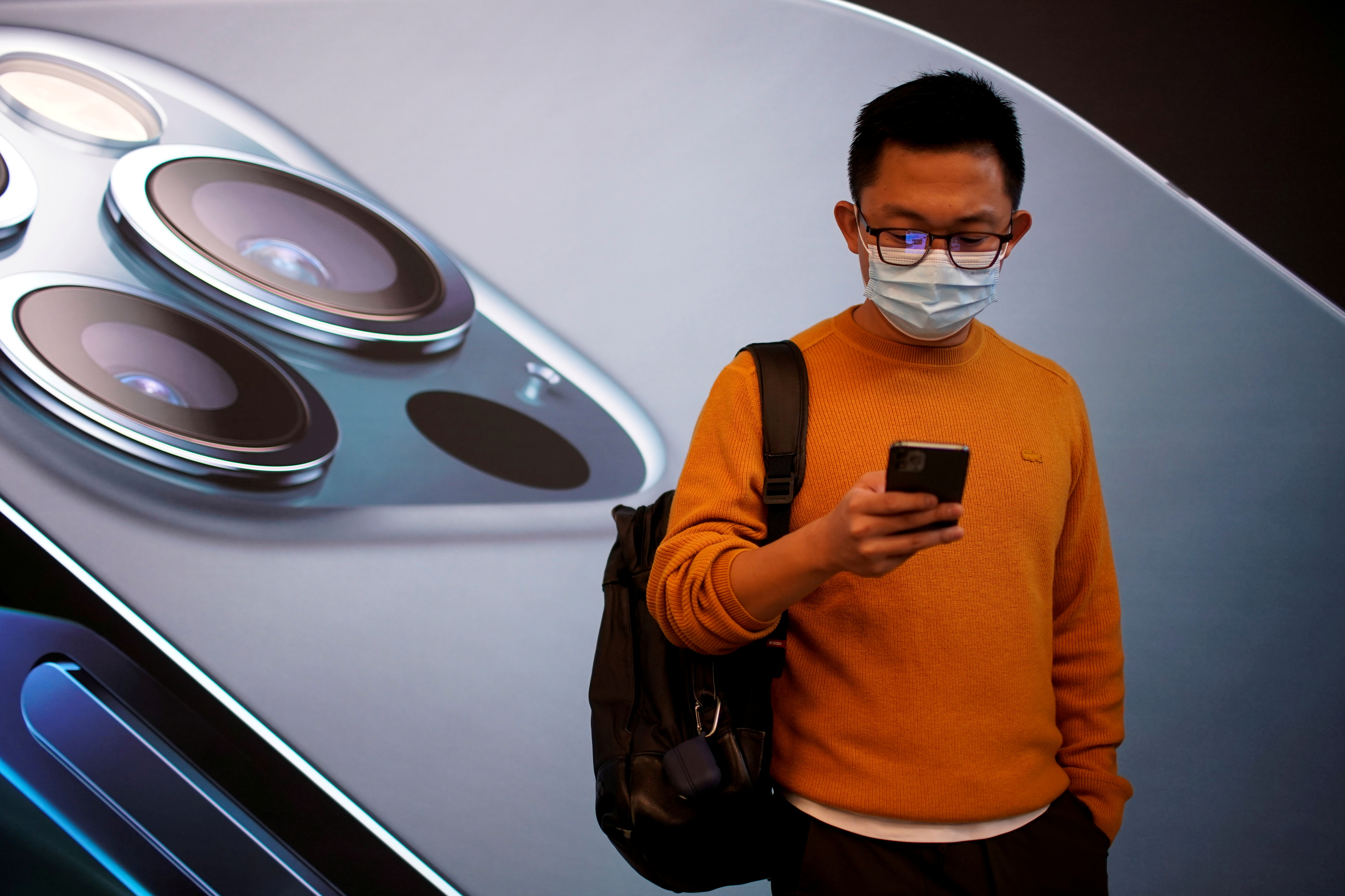 A man with a mask in the vicinity of an Apple store in Shanghai.