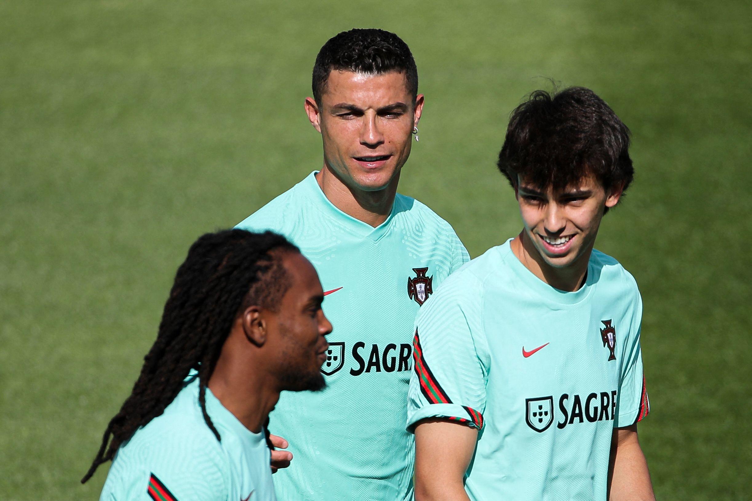 Joao Félix, junto a Cristiano, en un entrenamiento.