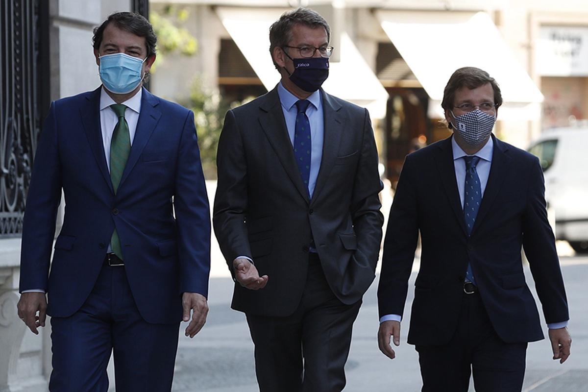 Feijóo, Mañueco y Almeida, este martes en Madrid.
