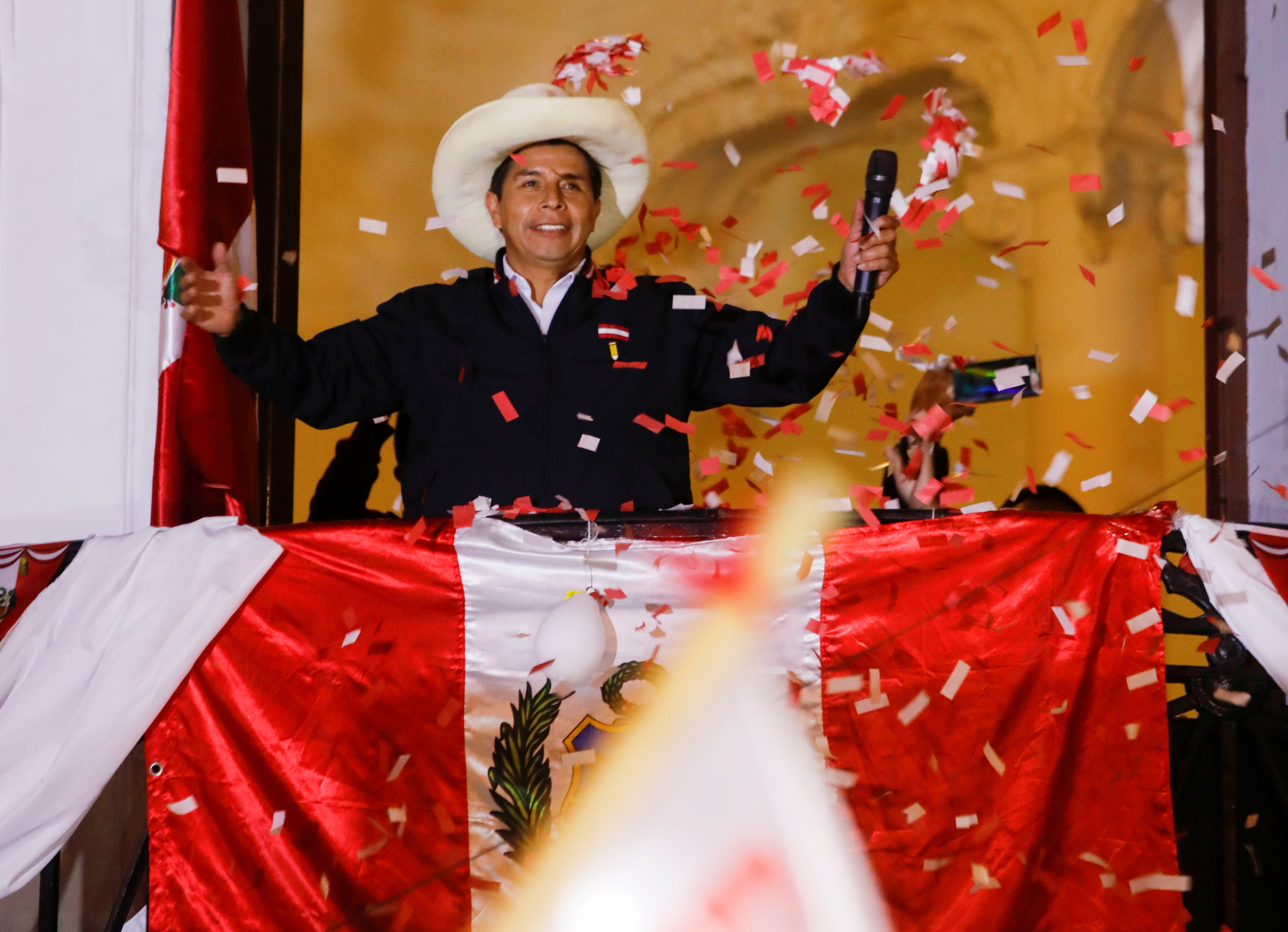 Pedro Castillo greets the supporters from the headquarters of Peru