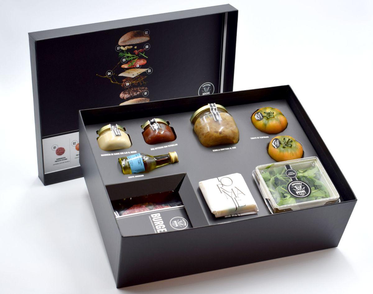 La caja contiene, además, pan, tomate, rúcula, queso, aceite y aderezos prémium.