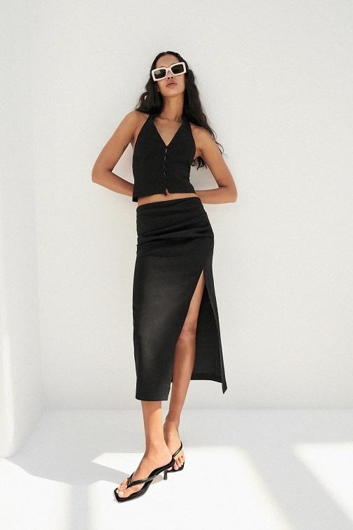 Falda de lino drapeada con apertura lateral por 25,95 euros