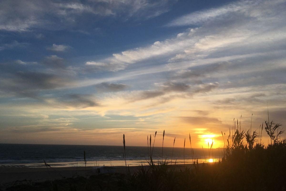 Puesta de sol desde la Playa de la Fontanilla.