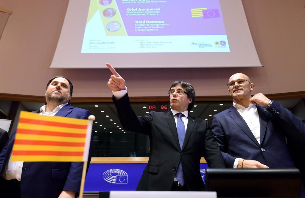 Junqueras, Puigdemont y Romeva, durante la promoción del referéndum en Bruselas, en enero de 2017.