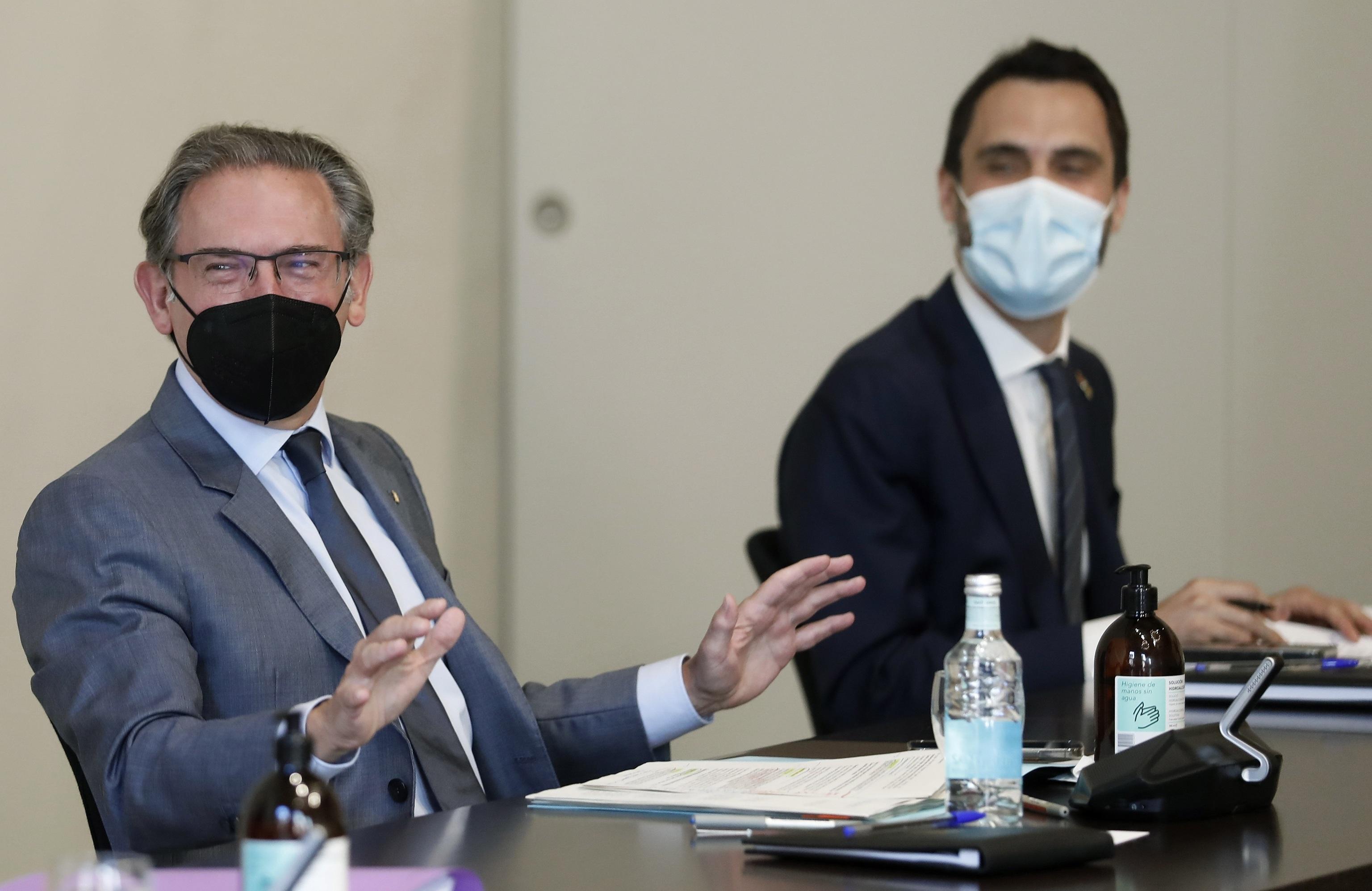 Los consejeros Jaume Giró y Roger Torrent.
