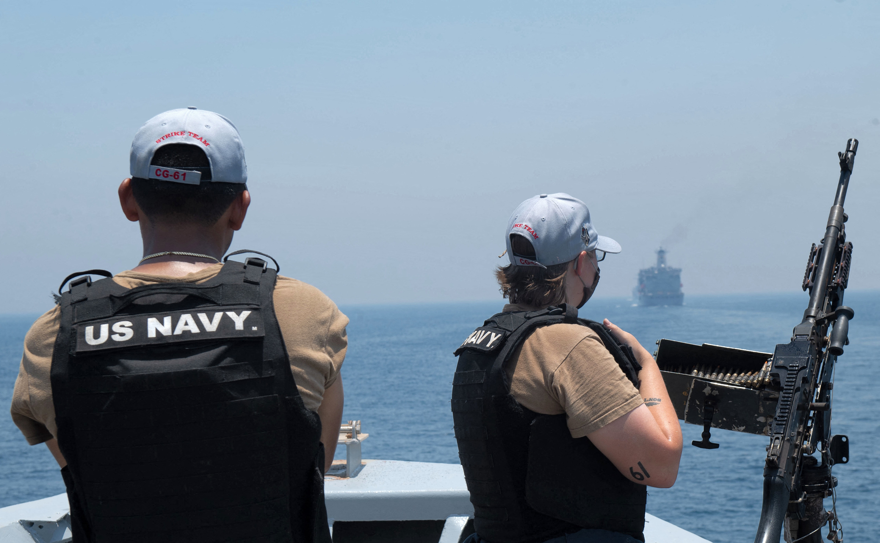 """This handout photo courtesy of US Navy and made available on June 3, 2021 shows US Navy personnel aboard the guided-missile cruiser USS Monterey (CG 61) looking on while the vessel transits through the Strait of Hormuz. - A Japanese-owned oil tanker that came under deadly attack off the coast of  lt;HIT gt;Oman lt;/HIT gt; is back sailing under her crew's control, its Israeli operator said on July 30. """"We can now confirm that the M/T Mercer Street is sailing under the control of her crew and under her own power at 14 knots to a safe location with a US naval escort,"""" Zodiac Maritime wrote on its Twitter page. (Photo by Chelsea PALMER / US NAVY / AFP) / XGTY / RESTRICTED TO EDITORIAL USE - MANDATORY CREDIT """"AFP PHOTO / US NAVY """" - NO MARKETING - NO ADVERTISING CAMPAIGNS - DISTRIBUTED AS A SERVICE TO CLIENTS"""