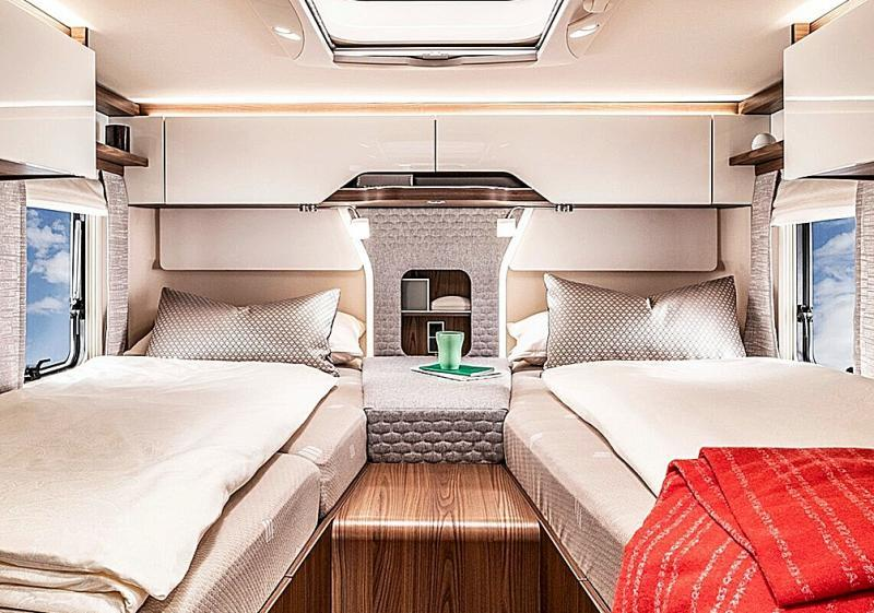 The luxurious bedroom of a premium integral caravan.