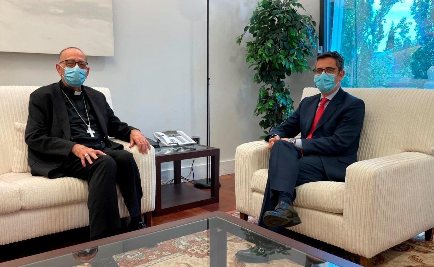 Juan José Omella y el ministro Félix Bolaños.
