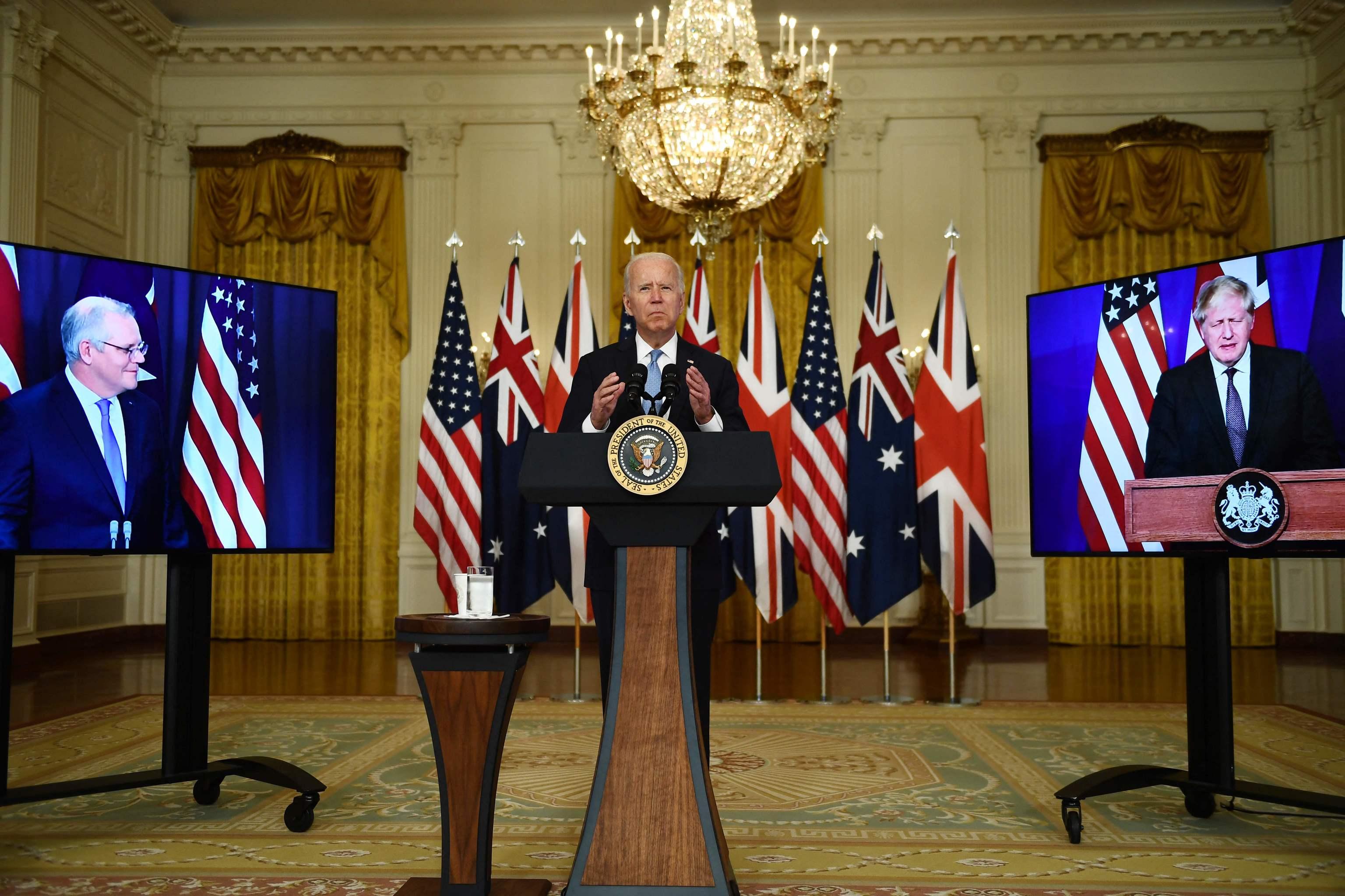 Biden, en una reunión virtual con Morrison y Johnson.