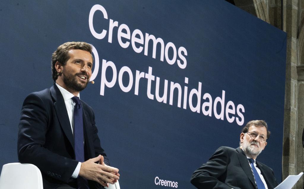 Pablo Casado y Mariano Rajoy participan, ayer, en la Convención del PP.