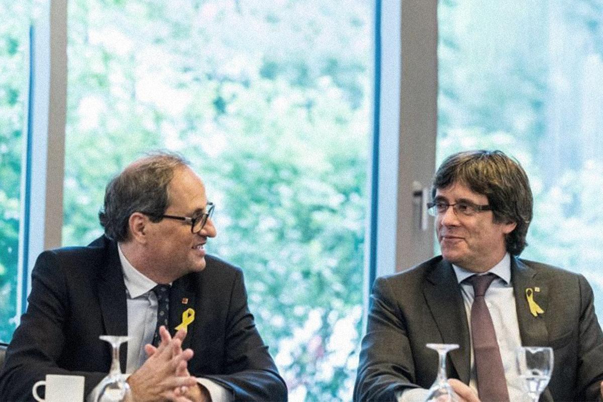 El ex presidente de la Generalitat Quim Torra reunido en 2018 con Carles Puigdemont, en Berlín.
