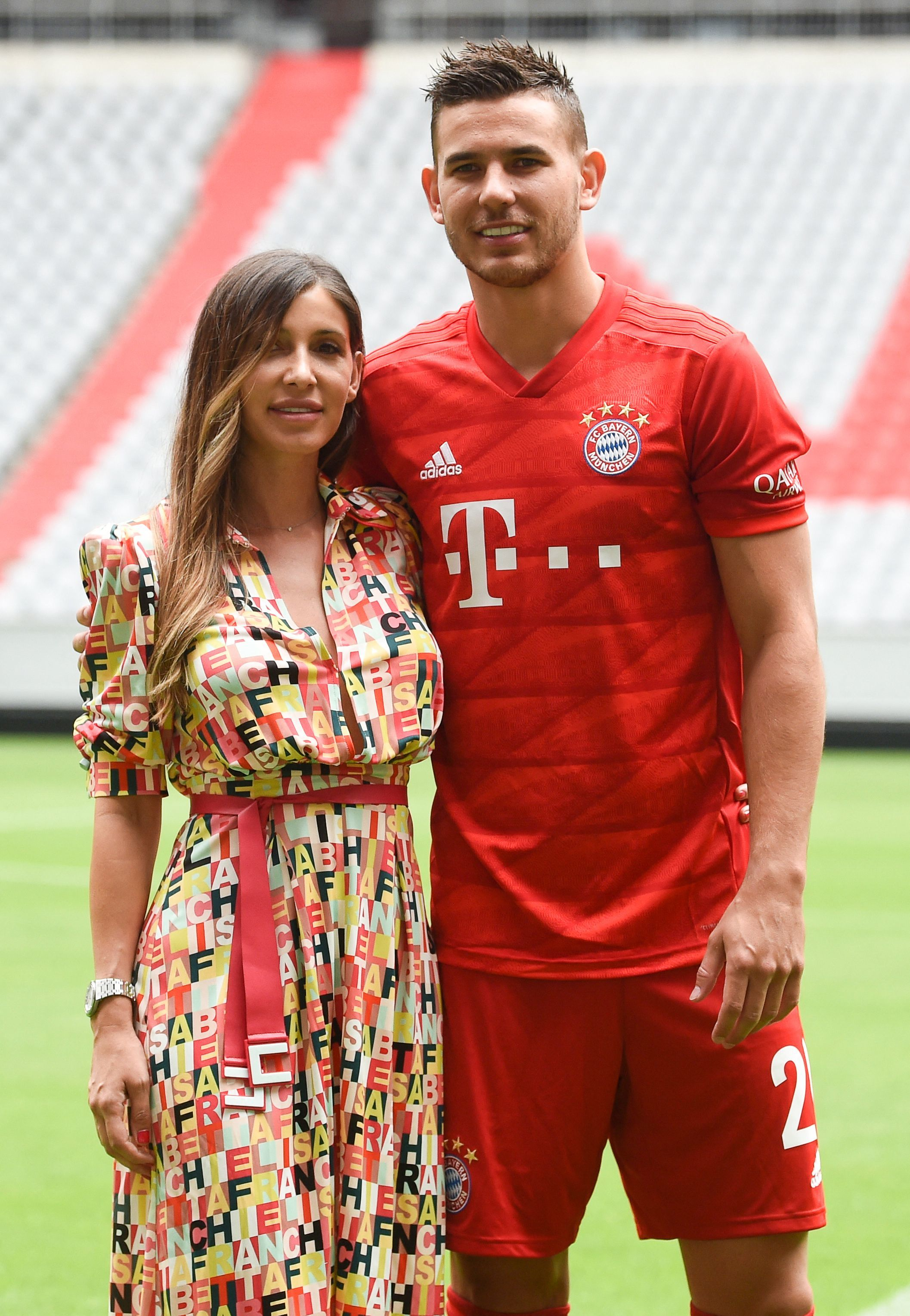 """(FILES) In this file photo taken on July 8, 2019 New Bayern Munich French defender  lt;HIT gt;Lucas lt;/HIT gt;  lt;HIT gt;Hernandez lt;/HIT gt; and his wife Amelia Llorente (L) pose after a presentation in the stadium in Munich, southern Germany. -  lt;HIT gt;Hernandez lt;/HIT gt; has been sentenced for domestic violence and has until October 28 to enter prison in Spain, unless his appeal is accepted, the Superior Court of Justice of Madrid (TSJ) announced in a statement. The 25-year-old player """"voluntarily presented himself at 11.30am today, one day before he was due to appear before the Madrid court, which ordered his detention,"""" the TSJ said. (Photo by Christof STACHE / AFP)"""