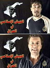 Christian Chesnot y Georges Malbrunot, en el vídeo que grabaron sus secuestradores. (AFP)