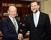 Rodrigo Rato y Mariano Rajoy, durante su reunión en Washington. (Foto: EFE)