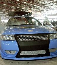 Uno de los coches que inspiran al vecino.