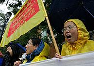 Practicantes del Falun Gong protestan por la visita. (Foto: REUTERS)