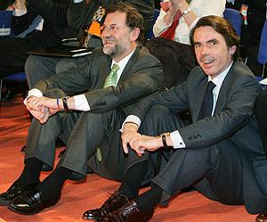 Aznar y Rajoy, durante la Convención . (EFE)
