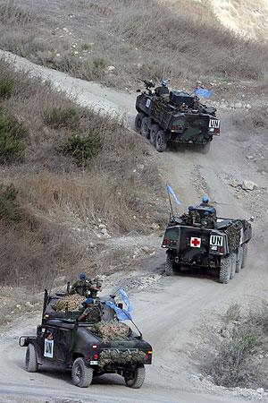 El convoy español rumbo a Taibe . (Foto: EFE)