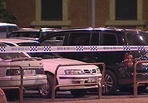 El párking del edificio, acordonado por la Policía Nacional. (Foto: TVE)