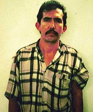 Foto del archivo policial de Luis Eduardo Garavito. (Foto: AP)