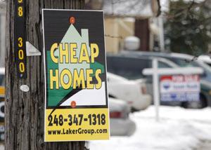 Cartel donde se ofrecen viviendas a precio reducido. (FOTO: GETTY IMAGES)