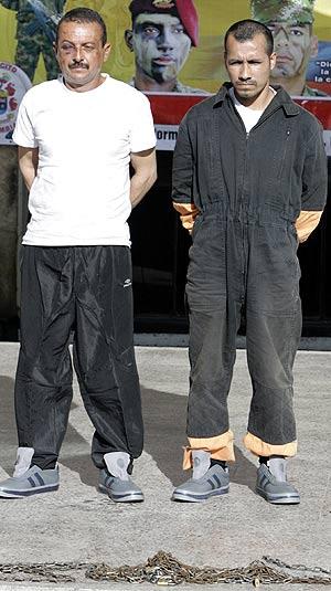 'César' y 'Gafas', los dos carceleros. (Foto: AFP)
