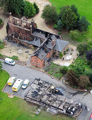 Vista aérea de la casa calcinada. (Foto: AP)