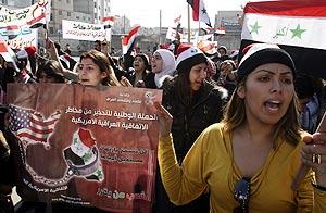 Manifestación en Damasco contra el pacto de seguridad firmado la pasada semana por EEUU e Irak. (Foto: AP)
