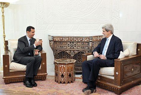 Kerry y Al Asad en su reunión de Damasco. | Afp