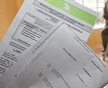 Documentos con la cantidad que adeuda Marta Berrones por las dos hipotecas.