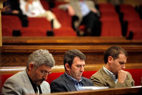 Robles, Domingo y y Rivera, en el Parlament. | Santi Cogolludo