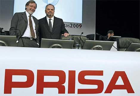 Juan Luis Cebrián e Ignacio Polanco en la última junta de accionistas de Prisa. (Foto: EFE)