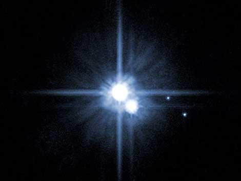 Imagen de Plutón y su luna, Caronte. | NASA.